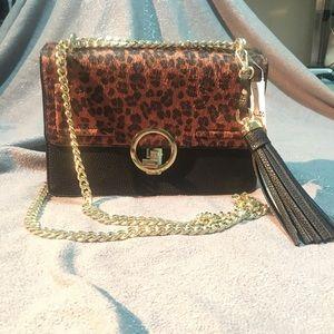 New Aldo purse. Leopard print and black gold chain